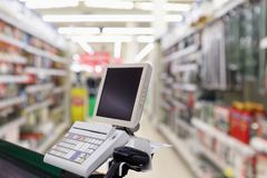 Supermarket checkout cash desk counter. With payment terminal Stock Photography