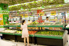 Supermarket in China. Food sales in a supermarket in China.As the inflation comes,the price in the market in China goes high. In the picture,some Chinese choose Royalty Free Stock Image