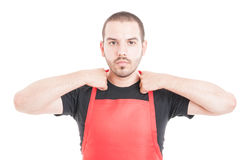 Supermarket clerk getting ready for work Royalty Free Stock Photos