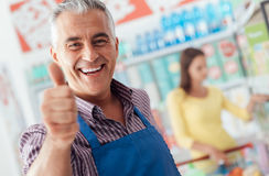 Supermarket clerk giving a thumbs up royalty free stock image