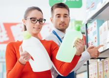 Supermarket clerk helping a customer Royalty Free Stock Images
