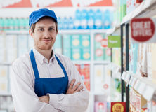 Supermarket clerk portrait. Confident smiling supermarket clerk posing at the shopping mall, retail job concept Royalty Free Stock Images