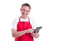 Supermarket clerk using touch screen tablet at work. To order new products on white background Royalty Free Stock Photo