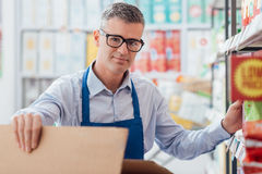Supermarket clerk at work Stock Image