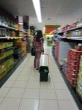 Woman with a shopping cart in a Supermarket Royalty Free Stock Photo