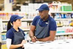 Supermarket colleagues stock photos