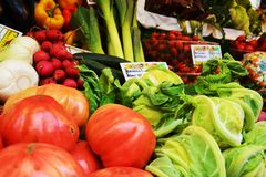 Supermarket and colorful vegetables in boxes royalty free stock images
