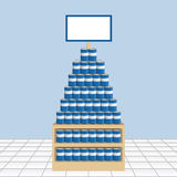 Supermarket Display of Cans with Blank Sign. A supermarket display of stacked cans on a display with a blank sign above Stock Image
