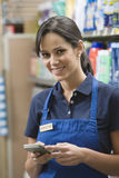 Supermarket Employee In Blue Apron Stock Photography
