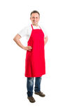 Supermarket employee or butcher with red apron Stock Photo
