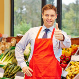 Supermarket employee holding thumbs up Stock Images