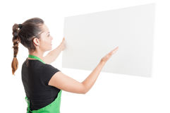 Supermarket employee looking at empty placard Stock Images