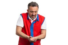 Supermarket employee shocked as trying to fix wrist royalty free stock photography