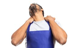 Supermarket employee touching aching back of neck. Supermarket or hypermarket indian employee touching aching back of neck with both hands isolated on white stock photography