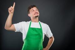 Supermarket employer posing like having good idea Royalty Free Stock Photography