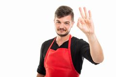 Supermarket employer showing ok or approval gesture Royalty Free Stock Photo