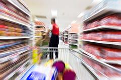 Supermarket. Empty supermarket aisle,motion blur Royalty Free Stock Image