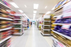 Supermarket. Empty supermarket aisle,motion blur Royalty Free Stock Photography