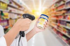 Supermarket Female cashier. Use code scanner, customer checkout Royalty Free Stock Image