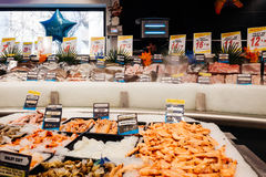 Supermarket fish counter. PARIS, FRANCE - FEB 4 , 2017: Supermarket counter stall with raw fish - fresh fish counter full with diverse - organic fish meat Stock Photos