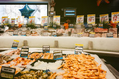 Supermarket fish counter. PARIS, FRANCE - FEB 4 , 2017: Supermarket counter stall with raw fish - fresh fish counter full with diverse - organic fish meat Stock Photography