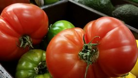 Supermarket: Fresh Heirloom Tomatoes Stock Photos