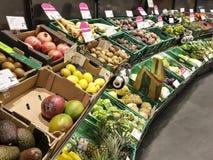 Supermarket fruit shelf vegetable crates boxes signs stock photo