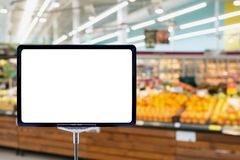 Supermarket grocery store blur background. Supermarket grocery store abstract blur background with blank price board royalty free stock image