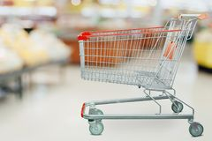 Supermarket grocery store with shopping cart. Supermarket grocery store with empty shopping cart stock images