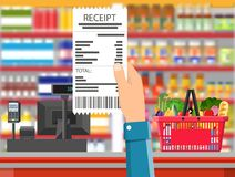 Supermarket interior. Cashier counter workplace. Hand with receipt. Basket with food and drinks. Shelves with products. Cash register, pos terminal and keypad Stock Images