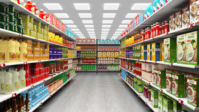Supermarket interior with shelves full Stock Image