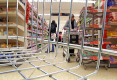 Supermarket isle basket trolley Stock Photography