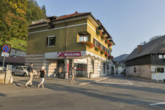 Supermarket Mercator on the road around Lake Bled in Slovenia. Unrecognized people walk along supermarket Mercator on the road around Lake Bled shore. Bled Lake Royalty Free Stock Images