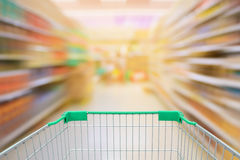 Supermarket motion blur aisle with shopping cart Royalty Free Stock Photo