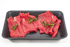 Supermarket packaged porterhouse steaks in white background Stock Photography