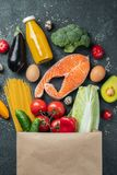 Supermarket. Paper bag full of healthy food stock images
