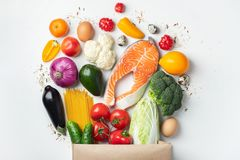 Supermarket. Paper bag full of healthy food stock image