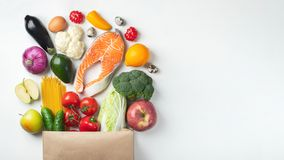 Supermarket. Paper bag full of healthy food royalty free stock photography