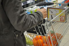 Supermarket. Person supermarket, hypermarket with shopping cart Stock Photos