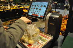 Supermarket. Person weighing products in supermarket, hypermarket Royalty Free Stock Photography