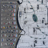 Supermarket roof and many cars in parking, viewed from above. Royalty Free Stock Image