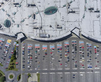 Supermarket roof and many cars in parking, viewed from above. Stock Photography