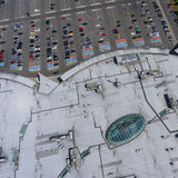 Supermarket roof and many cars in parking, viewed from above. Stock Photo