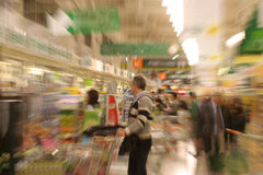 Supermarket: Rush hour. Supermarket on rush hour hysterical shopping, with in camera zoom blur effect Stock Photography