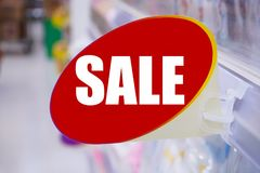 Supermarket sale sign display on shelves Royalty Free Stock Photo