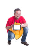 Supermarket seller holding modern tablet and smiling. On white background with copy text space Royalty Free Stock Photo