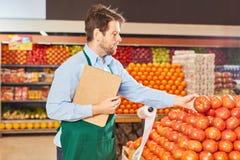 Free Supermarket Seller Inspects Vegetables Stock Images - 158856304