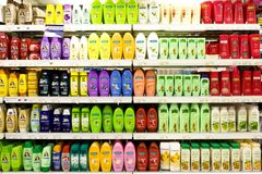 Supermarket shelf - shampoos Royalty Free Stock Image