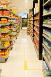 Supermarket Aisle. The aisle and shelves on the supermarket displaying variety of fast moving consumer good Royalty Free Stock Photo