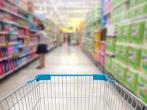 Supermarket shelves aisle blurred background Stock Photos